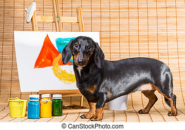 dachshund artist near easel with its masterpiece