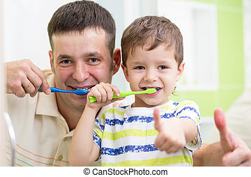 dad and child son brushing teeth in bathroom