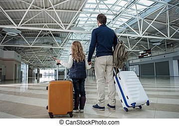 Dad and child standing with baggage - Father and daughter ...