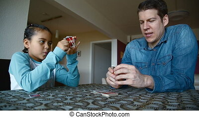 Dad and daughter playing cards