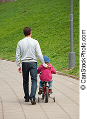 Dad and daughter walking in the park