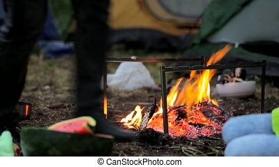 Dad and his daughter are fried on fire sausages. & Late evening in camp father and daughter sitting by the... stock ...