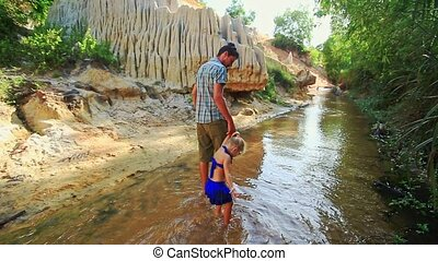 Dad and Little Girl Hold Hands Enjoy Fairy Stream Landscape