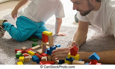 Dad and son are playing together