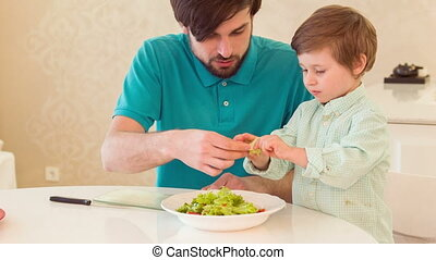 Dad and son cooking together