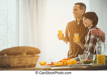 Dad and son enjoying healthy drink in morning