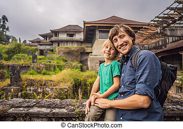 Dad and son tourists in abandoned and mysterious hotel in ...