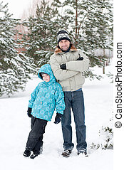 Dad and son walking in a winter park