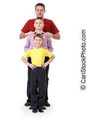 Dad and two sons are in a row on a white background