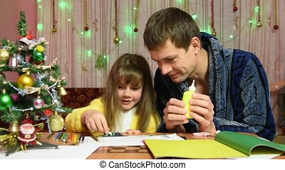 Dad helps daughter glued to the element of a Christmas...