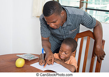 Dad helps his child to write . - The father said to his ...