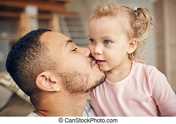Dad Kissing Little Daughter