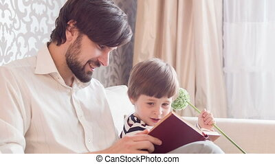Dad reading book his son