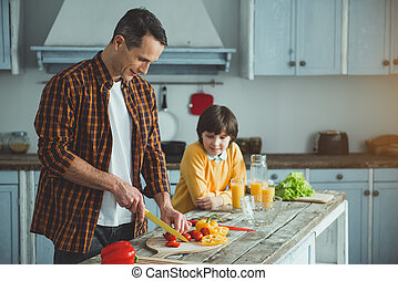Dad showing his kid cooking