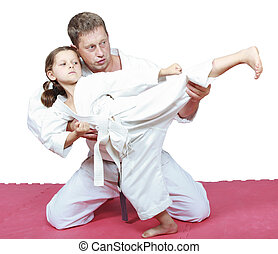 Dad teaches his daughter punch leg