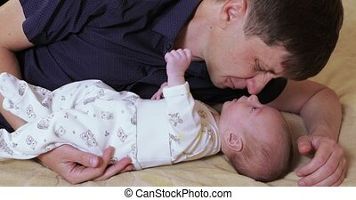 Dad with baby on the bed