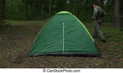 Dad with daughter put a tent