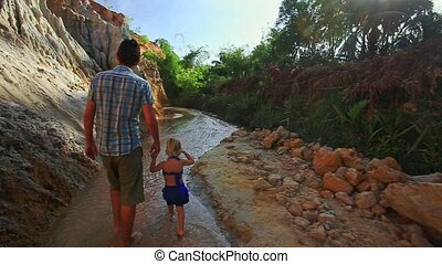Dad with Daughter Walk along Shady Fairy Stream Banks -...