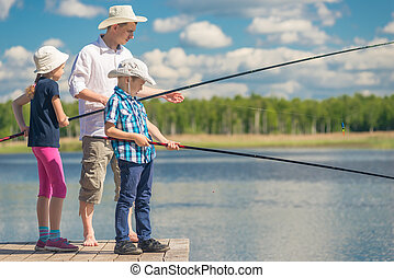 Dad with his daughter and son on a fishing weekend