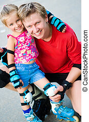 Dad with his daughter on the skates - Dad with his little...