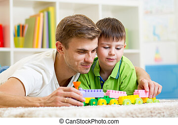 dad with his kid son play together