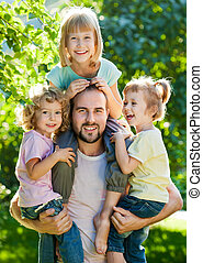 Dad with kids - Happy family having fun outdoors in spring...