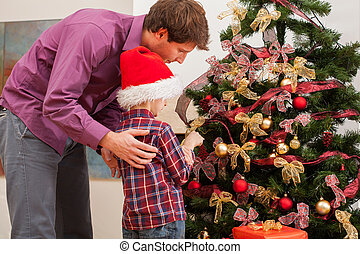 Dad with son decorating the tree