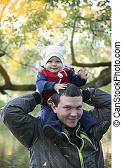 Dad with son on his shoulders