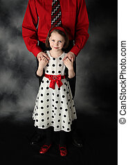 Daddy and daughter dressed up holding hands