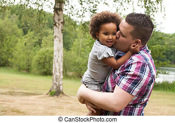 Daddy and his little girl - Blank father with his african...