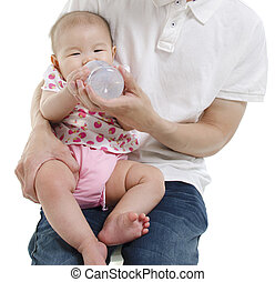 Daddy feeding water to baby