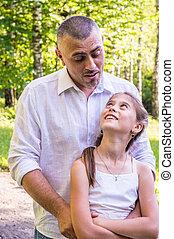 Daddy hugs his daughter