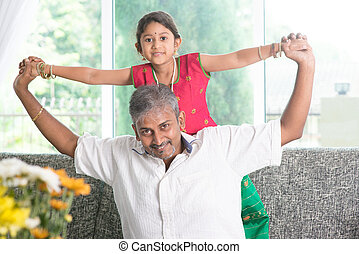 Daddy playing with daughter