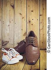 Daddy's boots and baby's sneakers, fathers day concept.