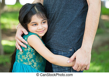 Daddys little girl - Closeup portrait, young child hugging...