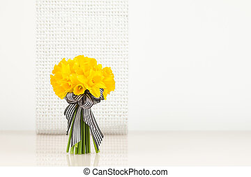 Daffodil bouquet on blur background - Yellow 'Tete a Tete'...