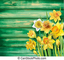Daffodils flowers on the wooden background