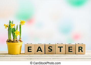 Daffodils on a table with the word easter