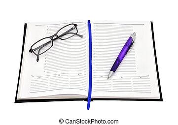 dagbok, penna, glasögon