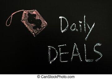 Daily deals concept written on a blackboard