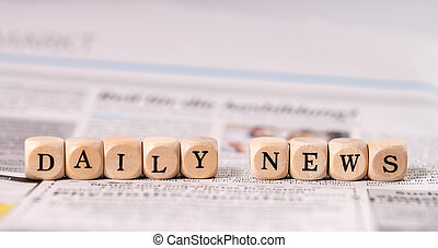 Daily News - Daily newspaper and small wooden cubes with the...