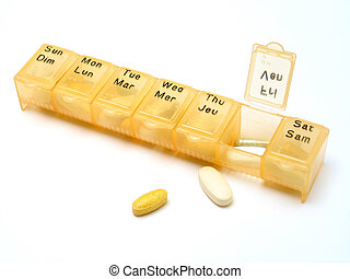 Daily Pills 2 - A daily pill container filled with various ...