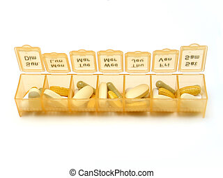 Daily Pills - A daily pill container filled with various...