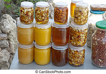 Canned in to honey fruit and nuts in glass jars