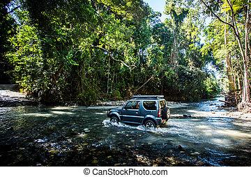 Daintree River Crossing Queensland Australia - A car drives ...