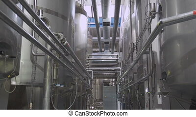 Dairy factory interior - Cisterns and pipes at the dairy...