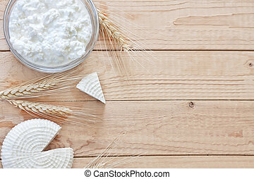 Dairy products and grains background - Tzfat cheese and...