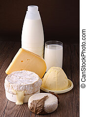 dairy products, cheese, milk, butter on wooden background