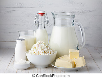 Dairy products, milk, cottage cheese, yogurt, sour cream and butter on wooden table