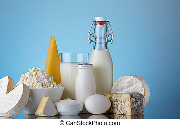 Dairy products on blue background with copy-space